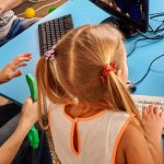 Image Showing Cute Happy Children Playing Video Games In PC.